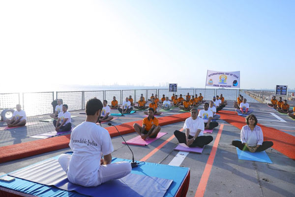 An Art of Living instructor leads a Yoga session for Navy officials on INS Kochi docked at Bahrain