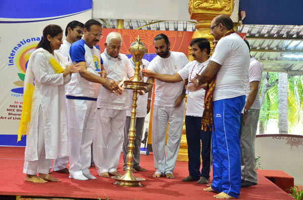 Yoga Day 2018 celebration. Seen lighting the traditional lamp at The Art of Living International Centre, Bengaluru, are Union Minister Mr. Sadananda Gowda, Minister of Statistics and Programme Implementation in the Government of India, Commodore Rao, Chairman, Vyakti Vikas Kendra India, and representatives from The Art of Living and Ministry of Ayush