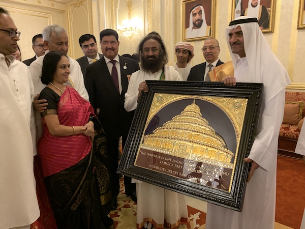 Gurudev presents a golden portrat of The Art of Living International Center to the Ruler of Fujairah